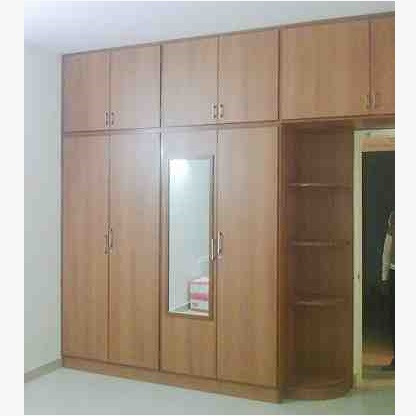 This is Affordable Fitted Corner Wardrobe. Code is HPD515. Product of Wardrobes - Since our fitted wardrobes are fully customized you can chose any combination of interior options including shelving, hanging and soft closing drawers etc. Al Habib